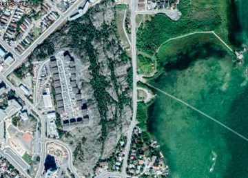 An aerial view of woodland surrounding Yellowknife's Twin Pine Hill developments