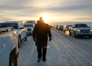 Attendees gather on the Inuvik-Tuk highway during an inaugural procession along the road on its opening day in November 2017