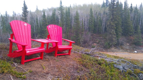 A view of chairs along the Wood Buffalo National Park's Benchmark Creek Trail near Grosbeak Lake.