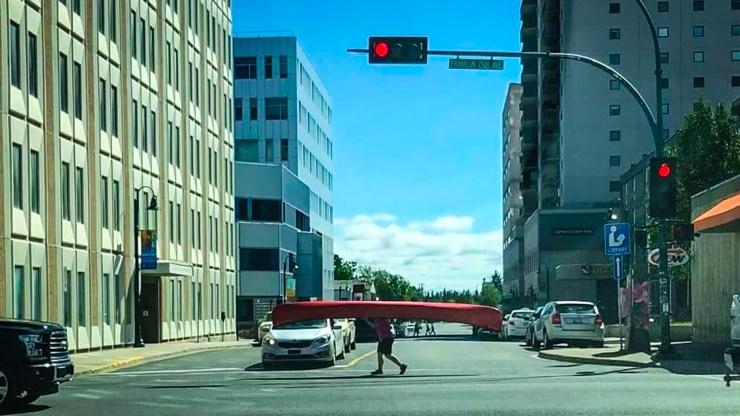Amanda Kanbari portages her canoe in downtown Yellowknife
