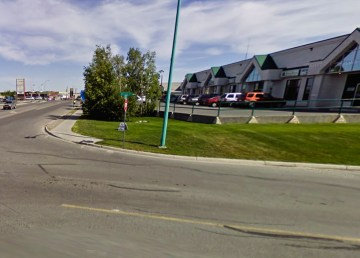 A 2009 Google Streetview image shows the corner of Range Lake Road and Woolgar Avenue