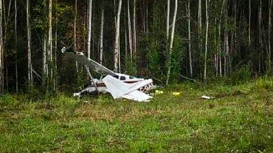 An aircraft is shown at rest in Nahanni Butte following a crash in August 2018