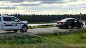 An image shared on Facebook in August 2018 appears to show RCMP talking to occupants of a black vehicle