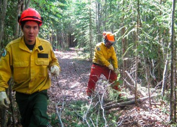 Firefighters work to FireSmart a community in the Northwest Territories, in the absence of fires requiring attention