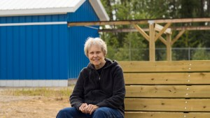 Dr Roberta Bondar sits outside of the Dr Roberta Bondar Northern Observatory in Fort Smith. Sarah Pruys/Cabin Radio.