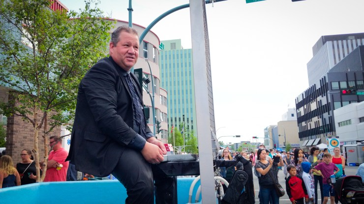 Glen Abernethy, the minister of health and social services, sits atop a dunk tank on Yellowknife's Franklin Avenue in June 2018