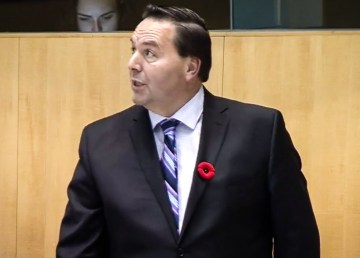 Infrastructure Minister Wally Schumann addresses the legislature on October 31, 2018