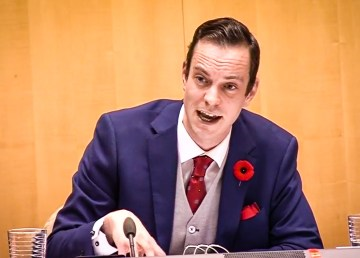 Kieron Testart appears in a webcast of proceedings at the Legislative Assembly on October 29, 2018