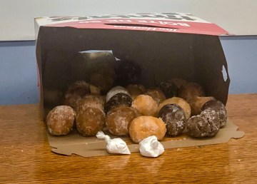 A photo issued by RCMP shows packages apparently of cocaine next to an open box of Timbits
