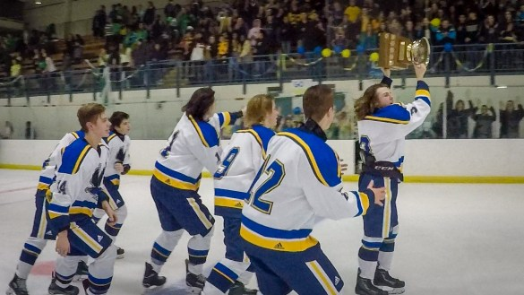 Sir John Franklin High School hockey players celebrate after victory in the 2018 Challenge Cup