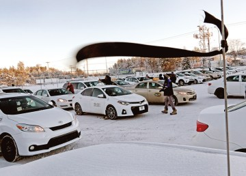 A black ribbon flies as cab drivers assemble for a procession through Yellowknife on December 10, 2018