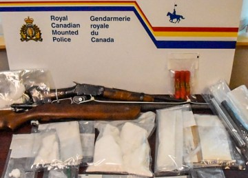 An RCMP handout image of a firearm and drugs seized during Project Gloomiest