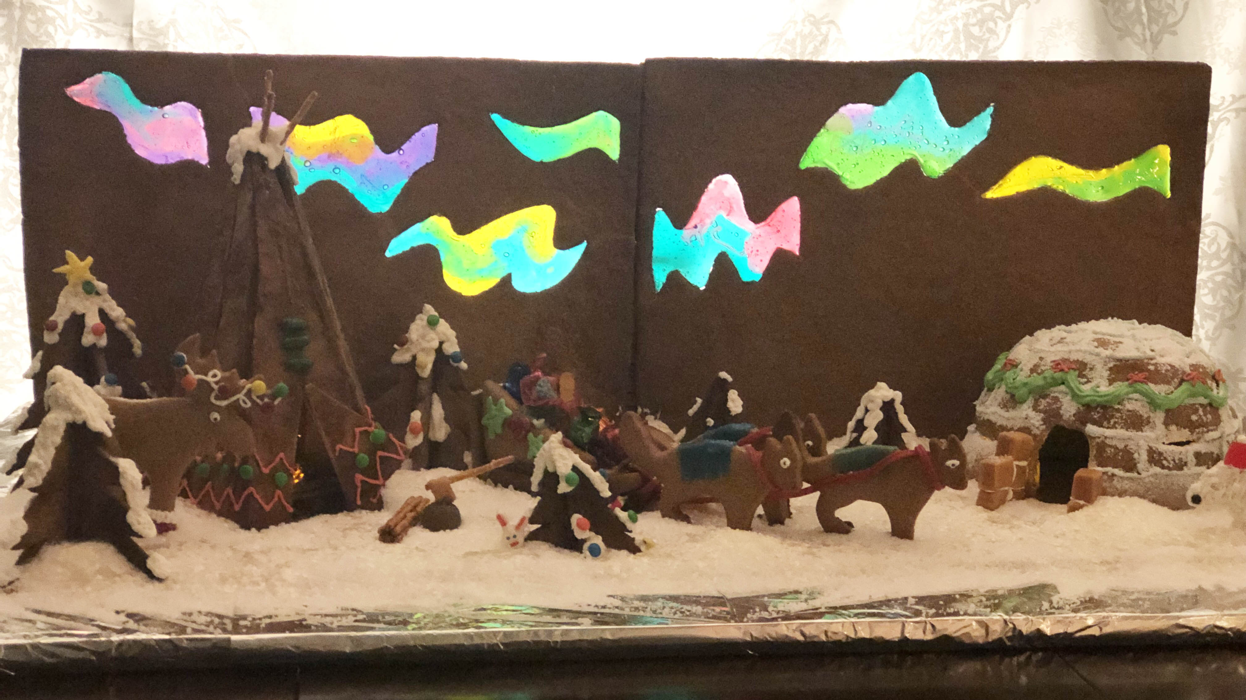 Northern lights glow in this entirely edible gingerbread scene.