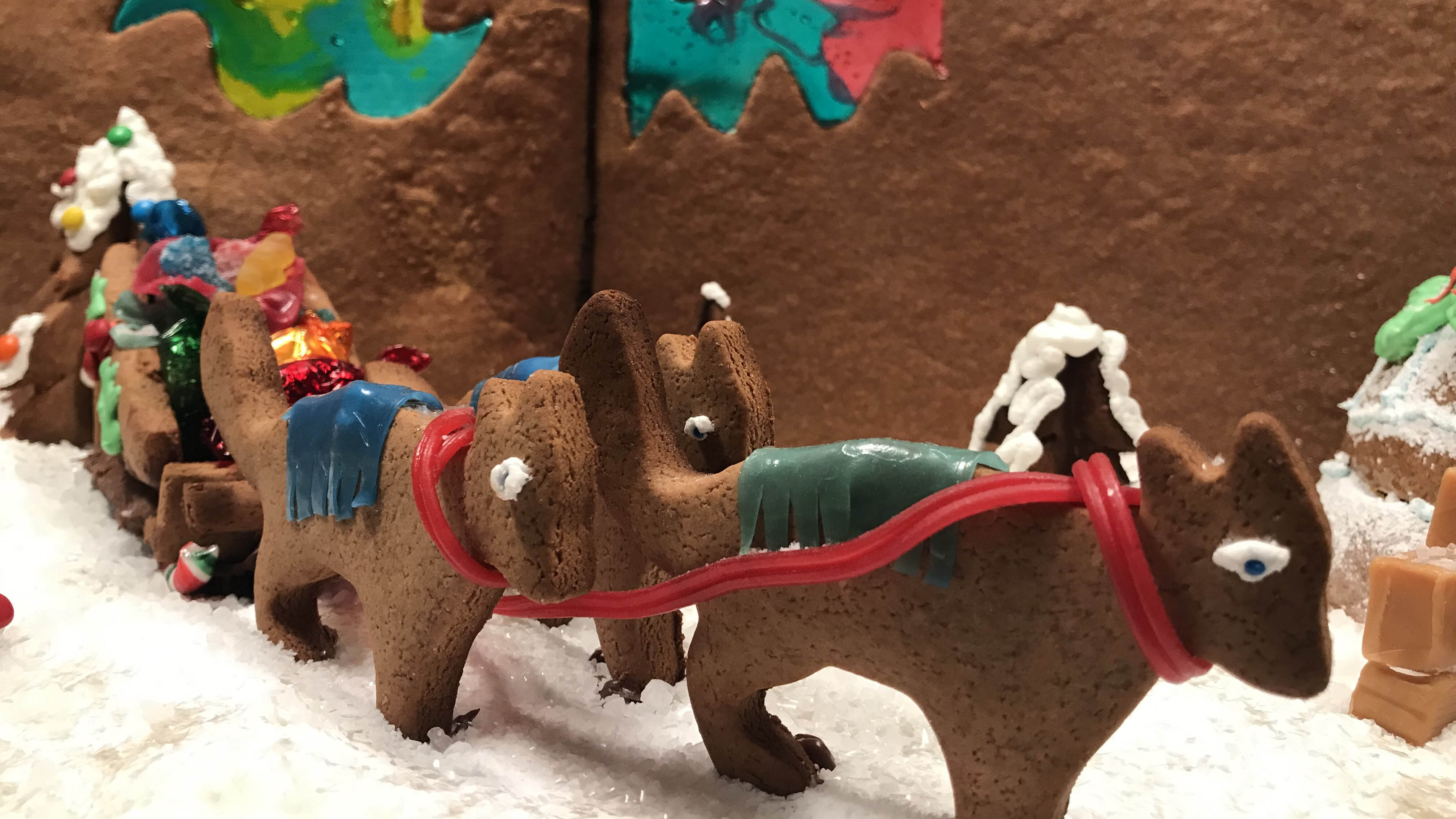 Gingerbread sled dogs pull a gingerbread sleigh filled with treats.