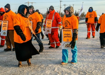 Union members take part in a 'practice picket' outside the NWT Power Corporation's Jackfish Lake power plant entrance on December 14, 2018