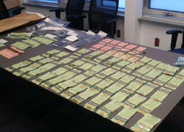 A submitted photo of the cash and items RCMP found when they arrested David Hevia.