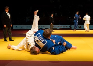 Wilson Elliot, in blue, defeats Ijob Hambraev for Canada Games judo bronze