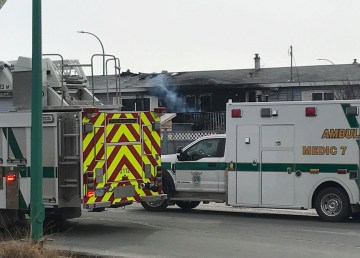A fire truck and ambulance attend a fire in Yellowknife's Kam Lake district on April 23, 2019