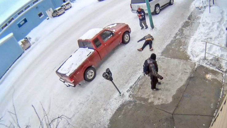 A still from security camera footage shows a woman apparently unconscious after being choked by an attacker on Yellowknife's 50 Street