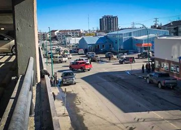 Emergency services line up outside Yellowknife's day shelter and sobering centre on April 9, 2019