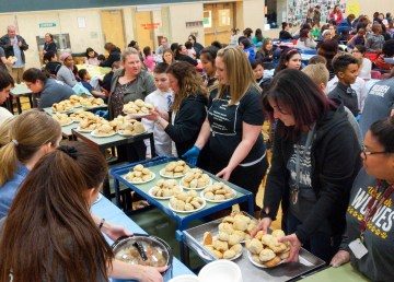 Trays of bannock wait to be distributed at the Weledeh Feast
