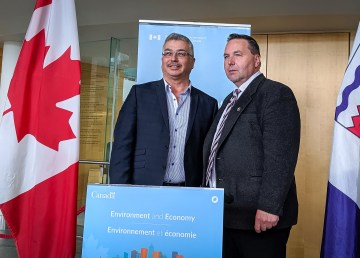 Liberal MP Michael McLeod and NWT industry minister Wally Schumann at a joint announcement in May 2019