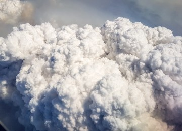 Smoke from the High Level wildfire billows into the air above northern Alberta in late May 2019
