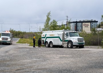 Firefighters respond to reports of smoke in brushland beside Yellowknife's museum on June 30, 2019