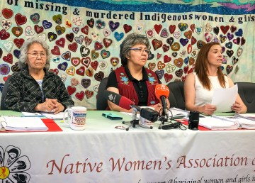 Members of the Native Women's Association of the NWT, with lawyer Caroline Wawzonek (right), address reporters in June 2019