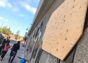 Plywood covers the window of a temporary holding cell at Yellowknife's courthouse