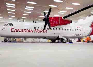 A Canadian North aircraft is pictured wearing the merged airline's new logo.