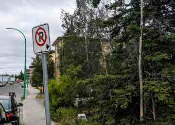 A sign prohibiting parking near the 54 Street lot on which Wayne Guy hopes to build a set of 12 mini-condos