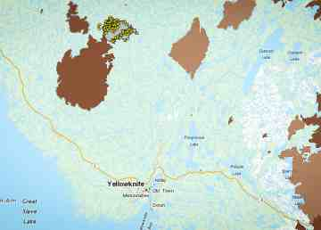 A wildfire northwest of Yellowknife, represented by yellow stars indicating satellite-observed hotspots, is seen on a map dated July 22, 2019