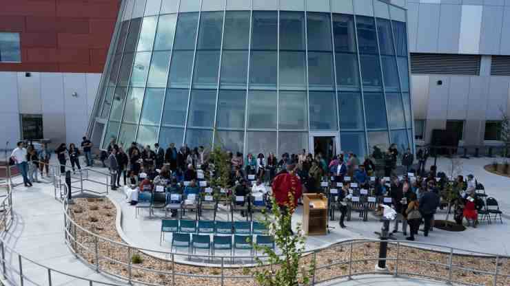 Seats start to fill up before the opening of the Stanton Territorial Hospital in July 2019. Sarah Pruys/Cabin Radio