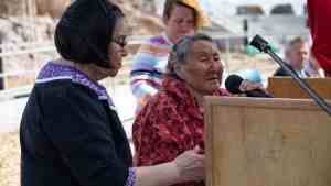 Mary Kudlak speaks before lighting the qulliq (a lamp) at the grand opening of the new Stanton Territorial Hospital in July 2019. Sarah Pruys/Cabin Radio
