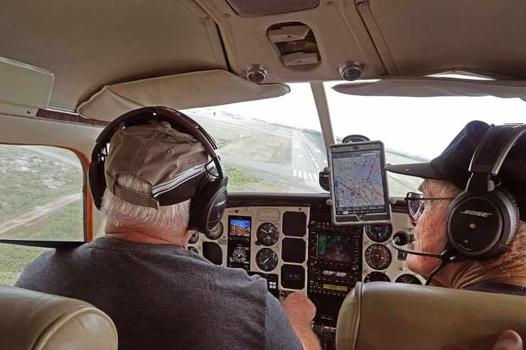 Veteran Yellowknife pilot Dave Crerar and his friend, fellow pilot John DeBourcier on final approach into Yellowknife Airport, returning from Plummer's Lodge.