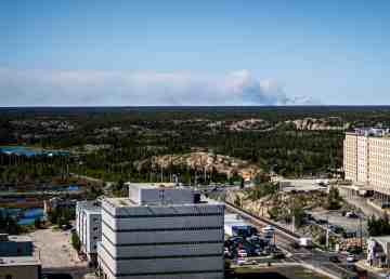 Wildfire ZF-024 is seen from the top of a downtown Yellowknife tower block on July 18, 2019