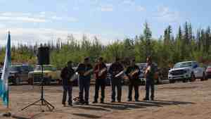 Drummers play at a ceremony marking the opening of construction on the Whatì all-season road in 2019