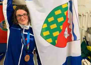 Leo Konge poses with a bronze medal and the NWT flag at the Western Canada Summer Games in August 2019