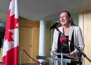 Minister Caroline Cochrane speaks at a funding announcement on August 8, 2019. Sarah Pruys/Cabin Radio