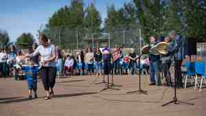People dance as the Kátł'odeeche First Nation Drummers perform at the RCMP Musical Ride. Sarah Pruys/Cabin Radio