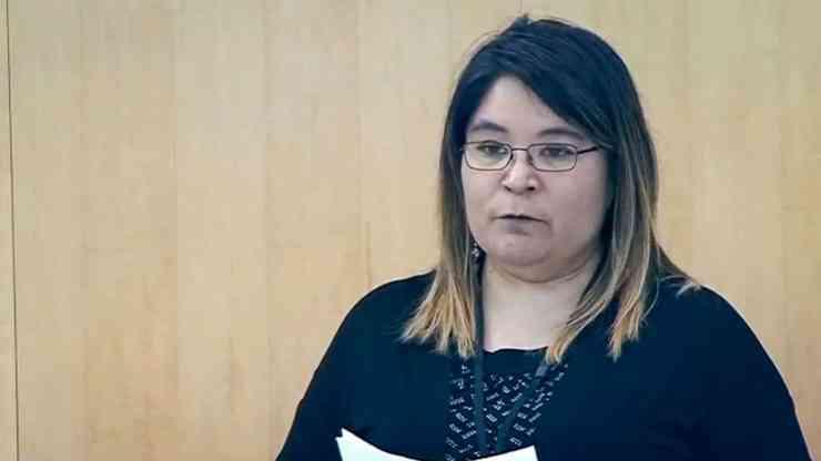 Paulie Chinna addresses the legislature in October 2019