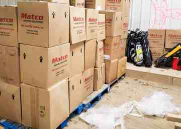 An RCMP handout image shows boxes of sports equipment provided to the hamlet of Fprt Providence