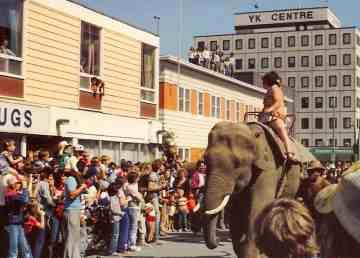 CJCD morning show host Ed Saunders ride an elephant down Franklin Avenue