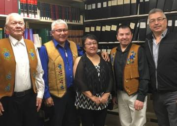 Leonard Kenny, in blue, together with his father Andrew John Kenny, left, wife Phebie Kenny, Délı̨nę's Ɂek'wahtı̨dǝ́ Leeroy Andre, and MP Michael McLeod attended the swearing in Tuesday. Photo: Twitter/Michael McLeod