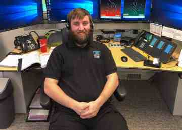 NWT 9-1-1 dispatcher Christopher Moore