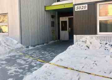 Police tape outside an apartment building on Yellowknife's 53 Street on March 31, 2020