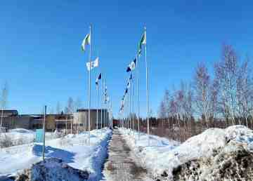 Flags of NWT communities line a walkway outside the Prince of Wales Northern Heritage Centre in Yellowknife
