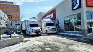 Supply trucks outside Yellowknife's Independent grocery store and Shoppers Drug Mart in April 2020