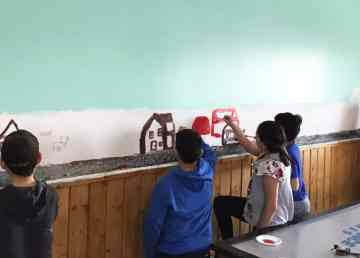 A submitted photo of Aklavik youth painting a mural in their youth centre